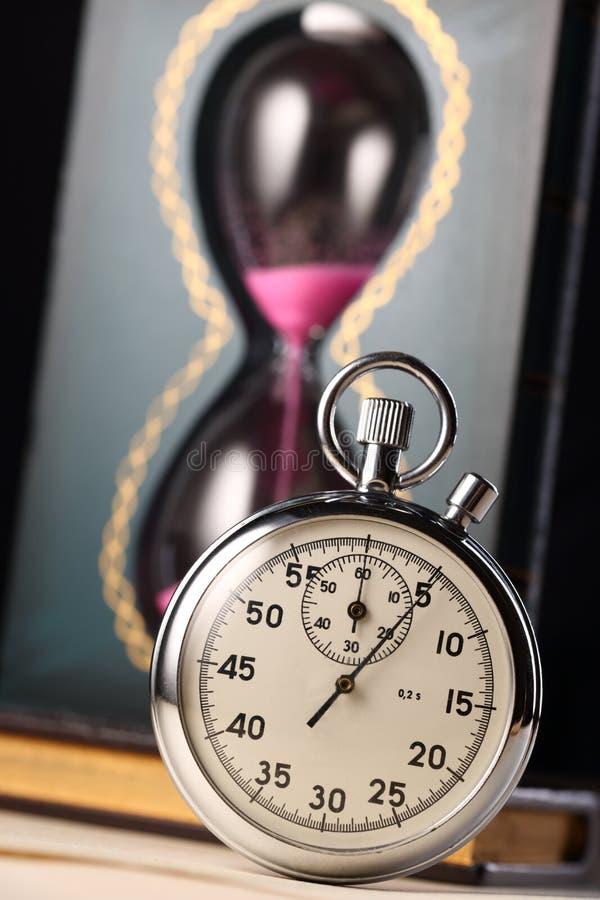 Montre de chronomètre et de sable photos libres de droits