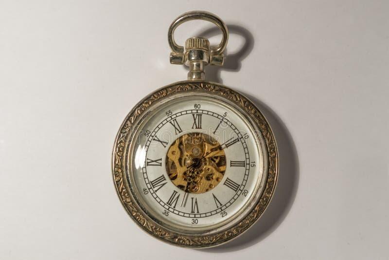 Montre de poche d'or et antique photographie stock libre de droits