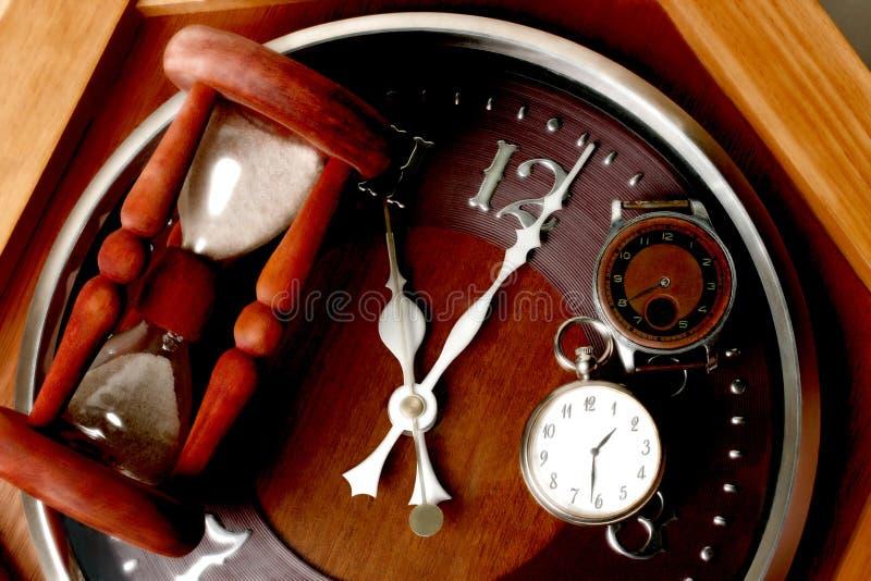 Montre, horloge et sablier de Brown photographie stock