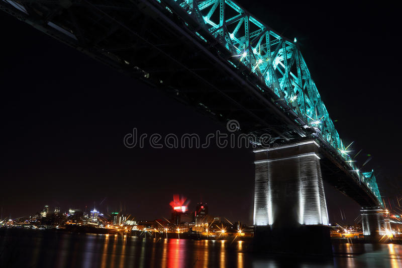 Montreal 375th anniversary. Jacques Cartier Bridge. Bridge panoramic colorful silhouette by night. Jacques Cartier Bridge Illumination in Montreal, reflection in royalty free stock image
