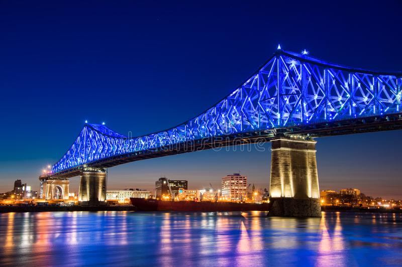 Jacques Cartier Bridge is lit up in blue. Montreal, CA - 13 April 2017: The Jacques-Cartier Bridge tests its new lighting system created by Moment Factory before royalty free stock photos