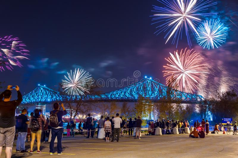 Jacques Cartier Bridge lights up for Montreal`s 375th. Montreal, CA - 17 May 2017: Jacques Cartier Bridge lights up for Montreal`s 375th anniversary stock photos