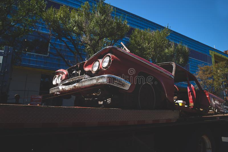 Montreal, Canada - August 13, 2018: Old American car rusty on a tow truck on the streets of Montreal. Close up. Travels in Canada stock image
