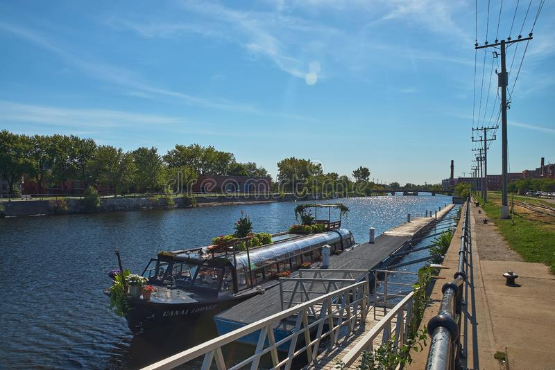 MONTREAL, CANADA - CIRCA SEPTEMBER 2018: Canal de Lachine on a sunny day. Pleasure boat at the pier. Travel in Canada royalty free stock photo