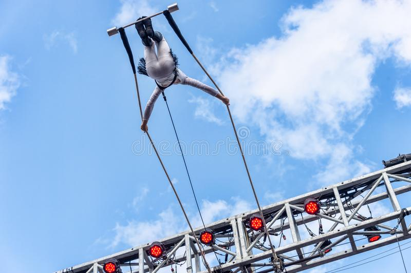 Trapeze artist performing outside. Montreal, Canada - 14 July 2018: Trapeze artist performing during Montreal Completement Cirque festival stock images