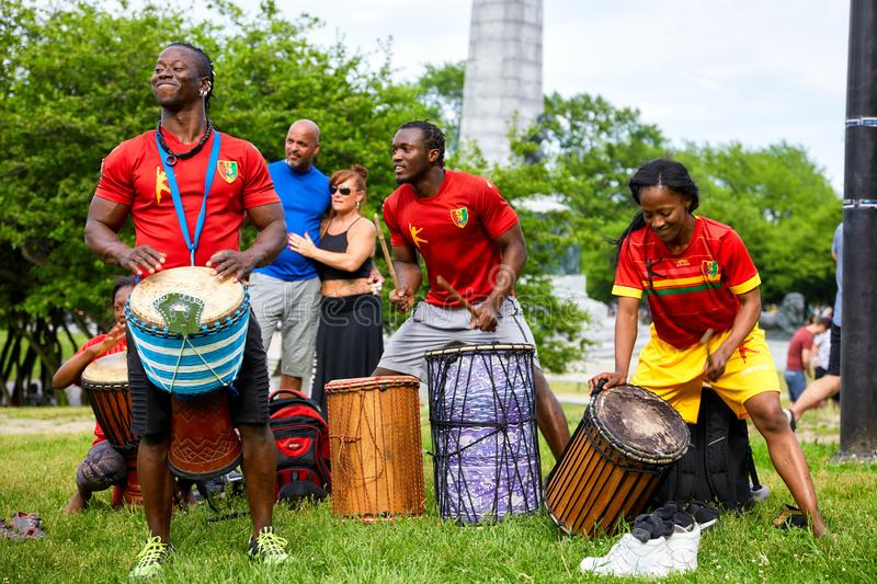 African American male and female percussionists playing djembe and dunun drums at Tam Tams festival in Mount Royal Park royalty free stock photos