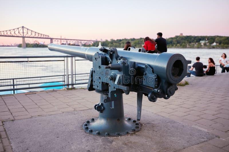 Artillery cannon at old port clock tower Quai de l`Horloge in Montreal, Quebec, Canada stock images
