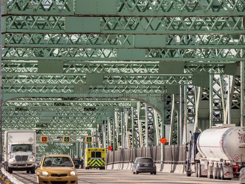Cars & truck traffic on the highway of Jacques Cartier bridge, in the direction to Montreal. stock image
