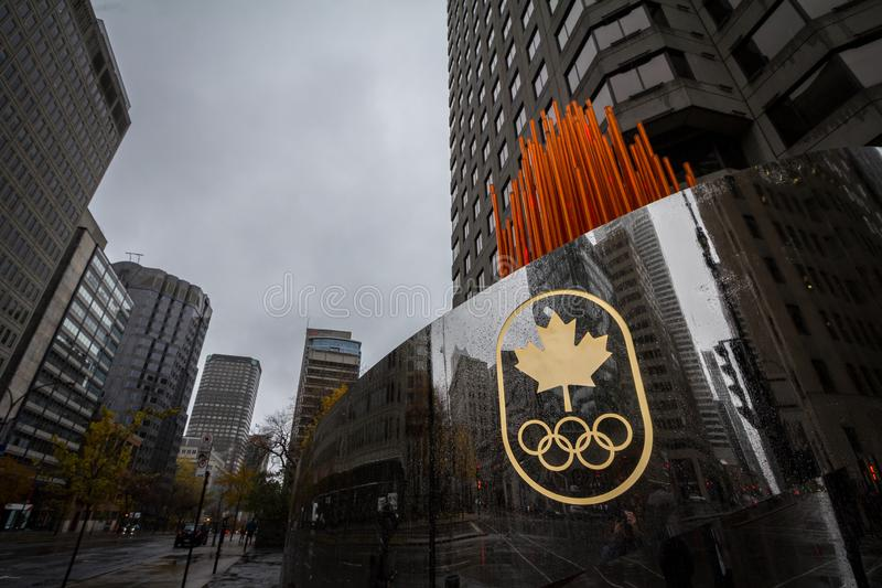 Canadian Olympic Committee logo with the Olympic rings on their headquarters in Montreal, Quebec. MONTREAL, CANADA - NOVEMBER 3, 2018: It is is in charge of stock images