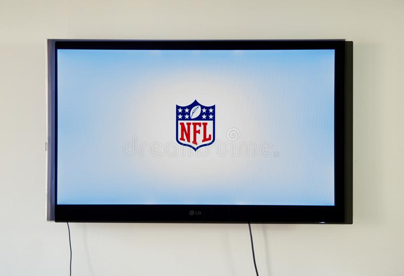 NFL app and logo TV on LG TV. MONTREAL, CANADA - NOVEMBER 15, 2017: NFL app and logo TV on LG TV screen. The National Football League is a professional American royalty free stock images