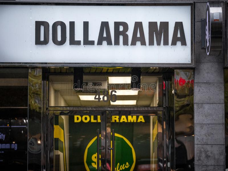 Dollarama logo in front of their local shop in downtown Montreal, Quebec. Dollarama is a Canadian chain of hard discount markets. MONTREAL, CANADA - NOVEMBER 5 royalty free stock photography