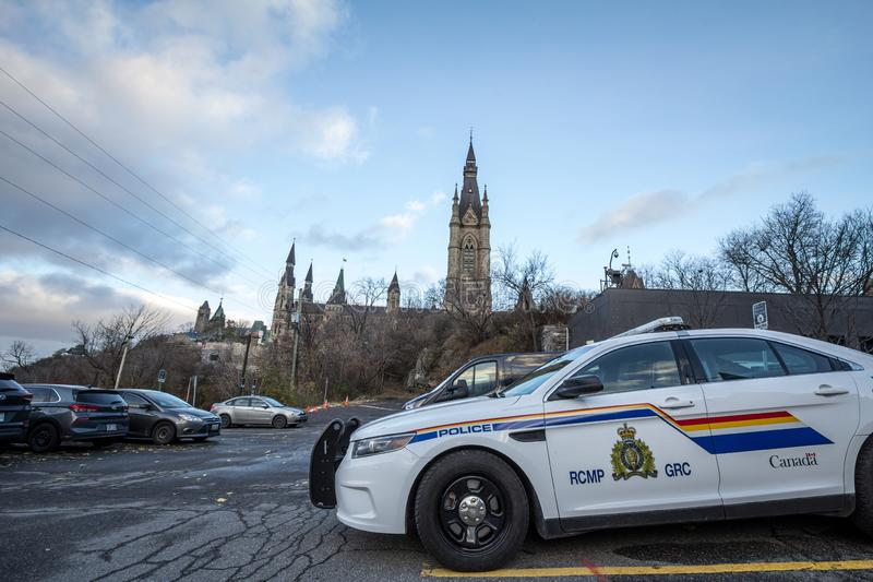 RCMP GRC Police car standing in front of the Canadian Parliament Building. MONTREAL, CANADA - NOVEMBER 10, 2018:  The Royal Canadian Mounted Police is the royalty free stock images