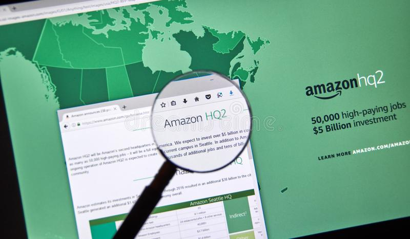 Amazon HQ2 description. MONTREAL, CANADA - OCTOBER 24, 2017: Amazon second headquarter description and map on official website under magnifying glass. Amazon HQ2 royalty free stock photos