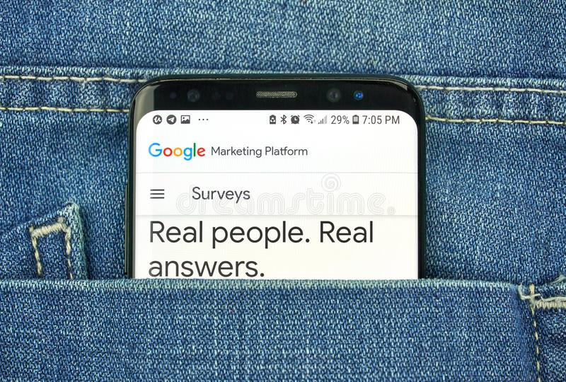 Google Surveys on a phone screen in a pocket stock photos