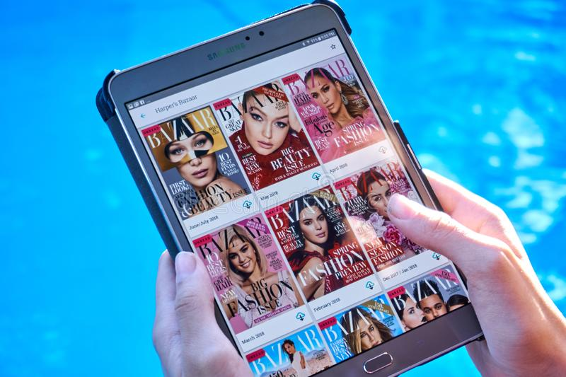 Bazar magazine on a Samsung Galaxy tablet screen. MONTREAL, CANADA - SEPTEMBER 8, 2018: Bazar magazine on a Samsung Galaxy tablet in hands royalty free stock photos