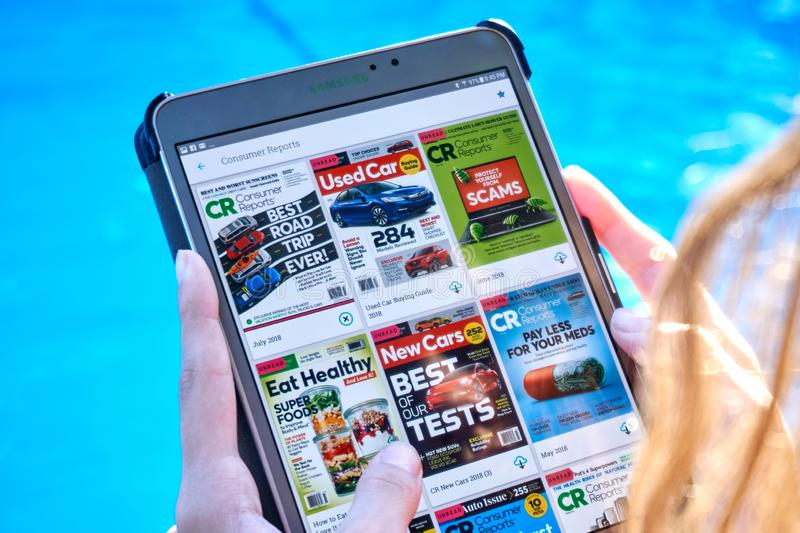 Consumer Report magazine on a Samsung Galaxy tablet screen. MONTREAL, CANADA - SEPTEMBER 8, 2018: Consumer Report magazines on a Samsung Galaxy tablet in hands stock images