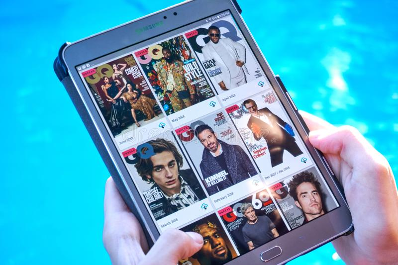 GQ magazine on a Samsung Galaxy tablet screen. MONTREAL, CANADA - SEPTEMBER 8, 2018: GQ magazines on a Samsung Galaxy tablet in hands royalty free stock images