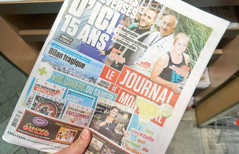 A hand holding Le Journal de Montreal newspaper. MONTREAL, CANADA - SEPTEMBER 14, 2018: Le Journal de Montreal newspaper in a hand. Le Journal de Montreal is a royalty free stock images