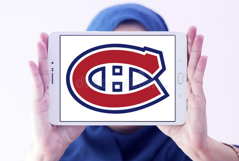 Montreal Canadiens ice hockey team logo. Logo of Montreal Canadiens club on samsung tablet holded by arab muslim woman. Montreal Canadiens are a professional ice royalty free stock images