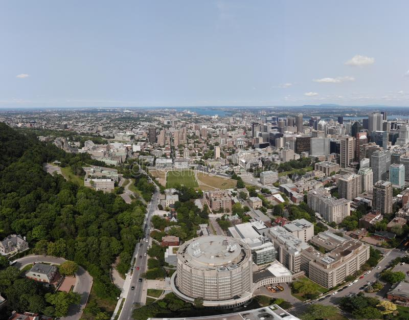 Montreal city drone aerial view in summer. Clouds, sunshine. royalty free stock images