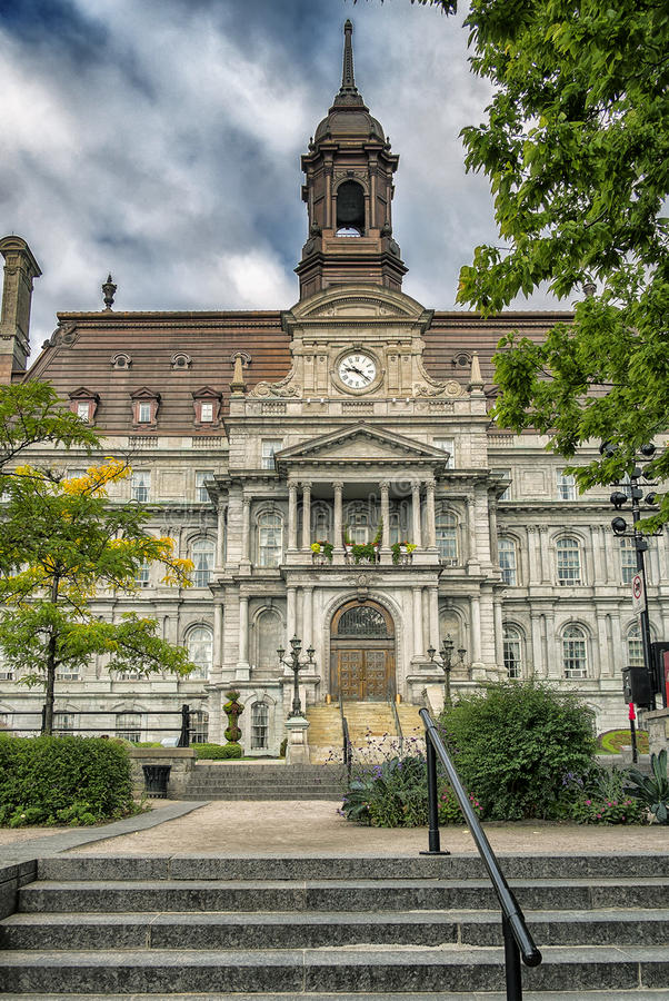 Montreal City Hall. The five-story Montreal City Hall French: Hôtel de Ville de Montréal is the work of architects Henri-Maurice Perrault and Alexander royalty free stock photography