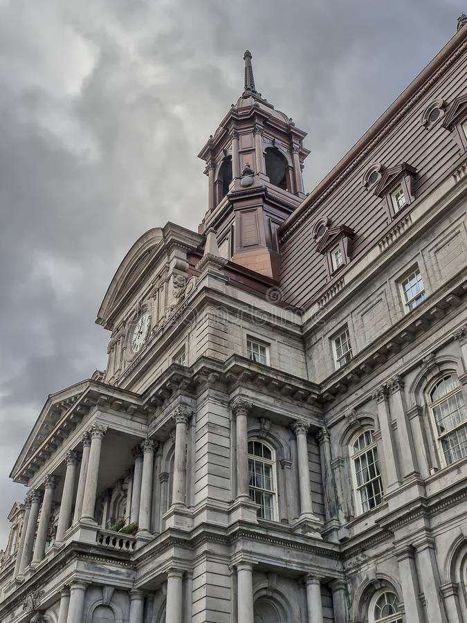 Montreal City Hall. The five-story Montreal City Hall French: Hôtel de Ville de Montréal is the work of architects Henri-Maurice Perrault and Alexander royalty free stock photo