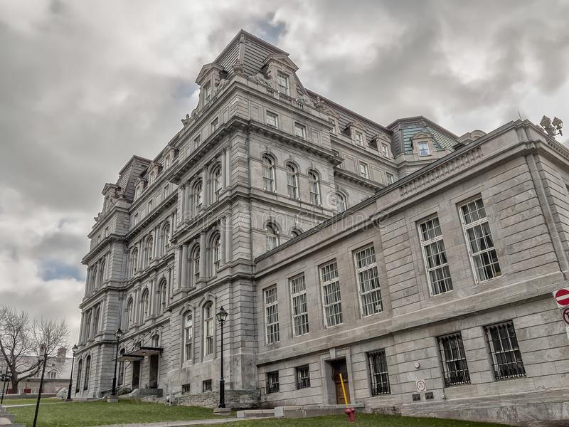 Montreal City Hall side view. The five-story Montreal City Hall French: Hôtel de Ville de Montréal is the work of architects Henri-Maurice Perrault and stock images