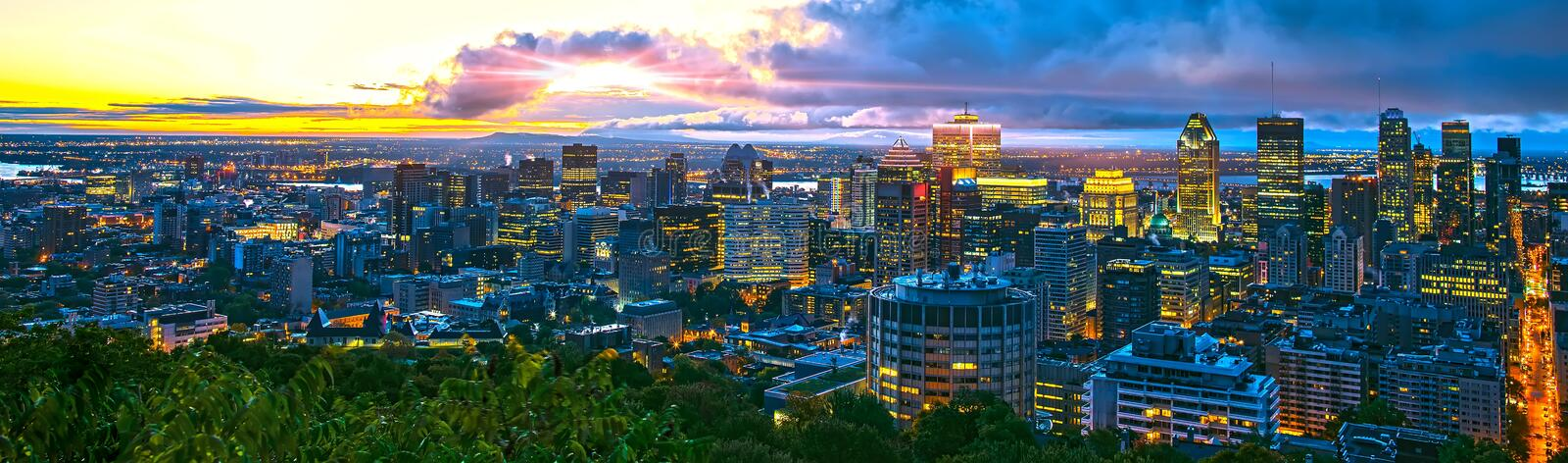 Montreal city at sunrise in the beautiful morning. Amazing view from Mont-Royal with colorful blue buildings. Stunning panorama of stock photography