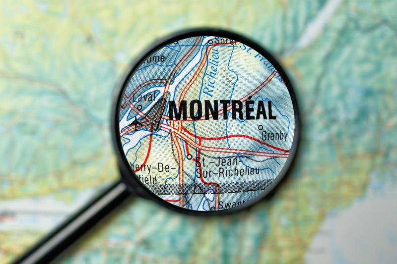 Montreal magnified on a map. Close up of Montreal under a magnifying glass on a map royalty free stock photos
