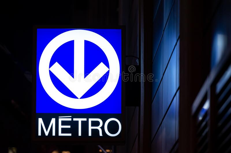 Montreal metro sign at night. Montreal Quebec Canada January 22 2020: Montreal metro sign, at night reflecting light indicating a subway station, this stock photos