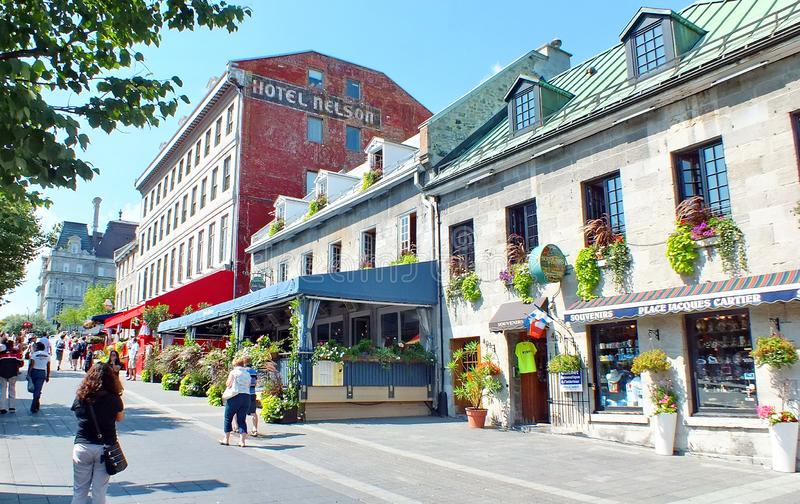 People mill about the streets in Old Montreal stock photography