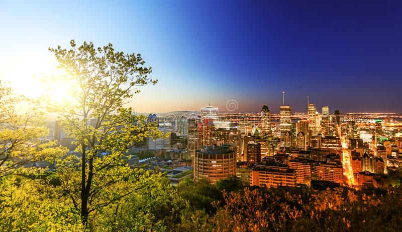 Montreal, Quebec, Canada: May 21, 2018. Conceptual picture with. Montreal town, panoramic view from Belvedere. At the border of sunrise in the Montreal royalty free stock photography