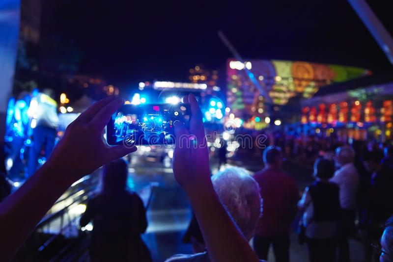 Montreal, Quebec, Canada, September 6, 2018: Des Arts Square, people who are waiting for the concert, a bright bright. Light, as well as listening to music in royalty free stock images
