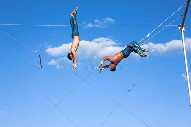 Trapeze show 2 men acrobat outdoor Montreal royalty free stock photography