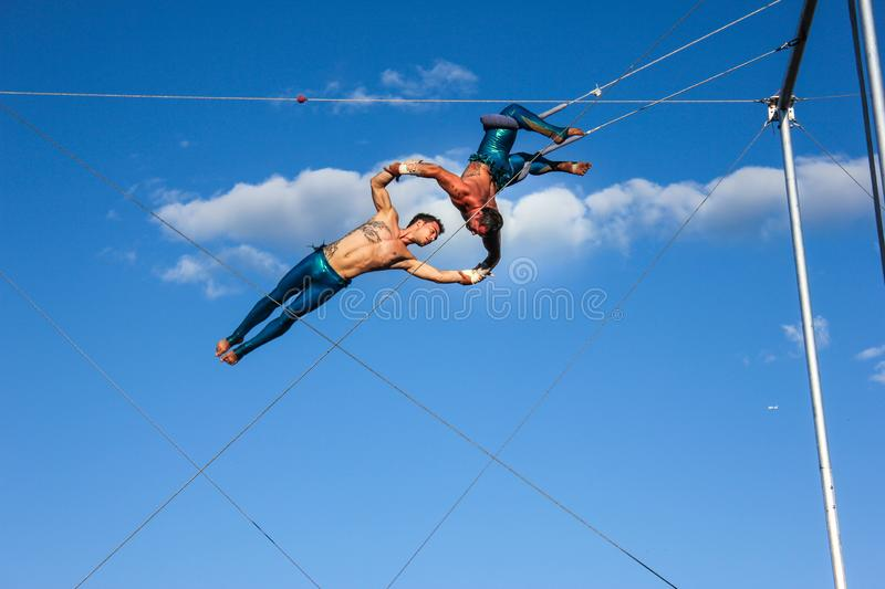 Trapeze show 2 men acrobat show outdoor Montreal royalty free stock images