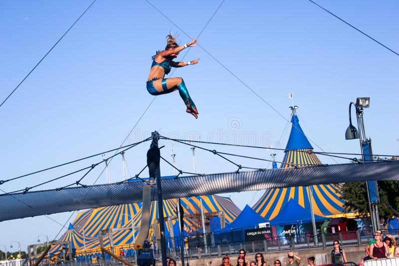 Trapeze women acrobat outdoor Montreal royalty free stock image