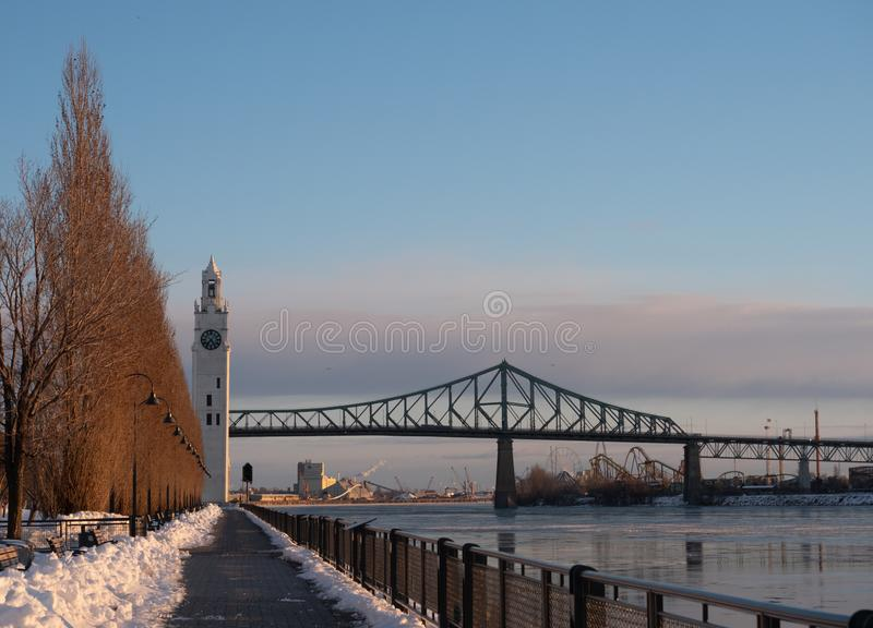 Montreal`s Clock Tower and Jacques Cartier Bridge in the Winter royalty free stock photography
