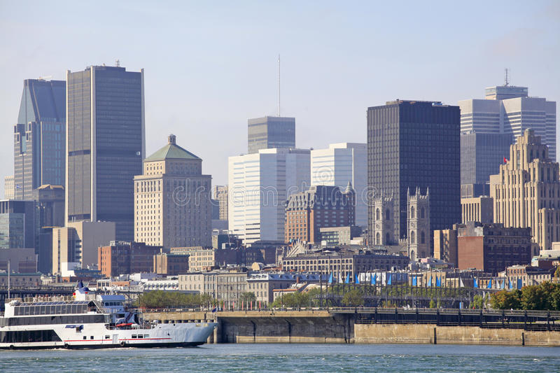 Montreal skyline and cruise boat reflected into Saint Lawrence River, Canada stock images