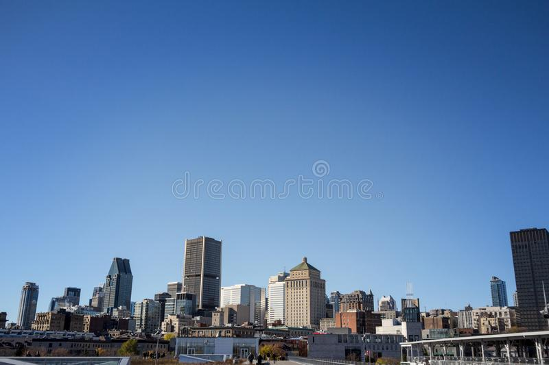 Montreal skyline, with iconic buildings of old Montreal Vieux Montreal and CBD business skyscrapers taken from the port. royalty free stock photo