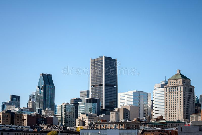 Montreal skyline, with the iconic buildings of the old Montreal Vieux Montreal and the CBD business skyscrapers taken from port. Montreal is the main city of stock photo