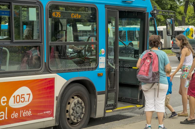Montreal scene public bus. Montreal Transit Corporation is a public transport agency that operates transit bus, and rapid transit services in Montreal, Quebec royalty free stock image