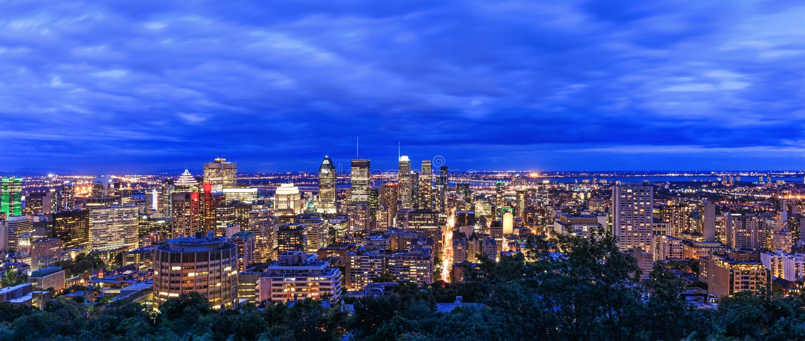Montreal view at sunrise or sunset time with blue sky. Panoramic skyline of Canadian city. Beautiful night clouds over Montreal. Downtown buildings. Amazing royalty free stock photos