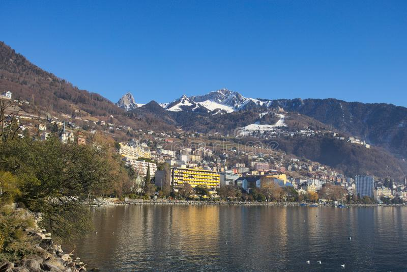 Montreux cityscape with panoramic mountains in the background seen from across the lake. Montreux, Switzerland - 02 17, 2019: Montreux cityscape with panoramic stock photo