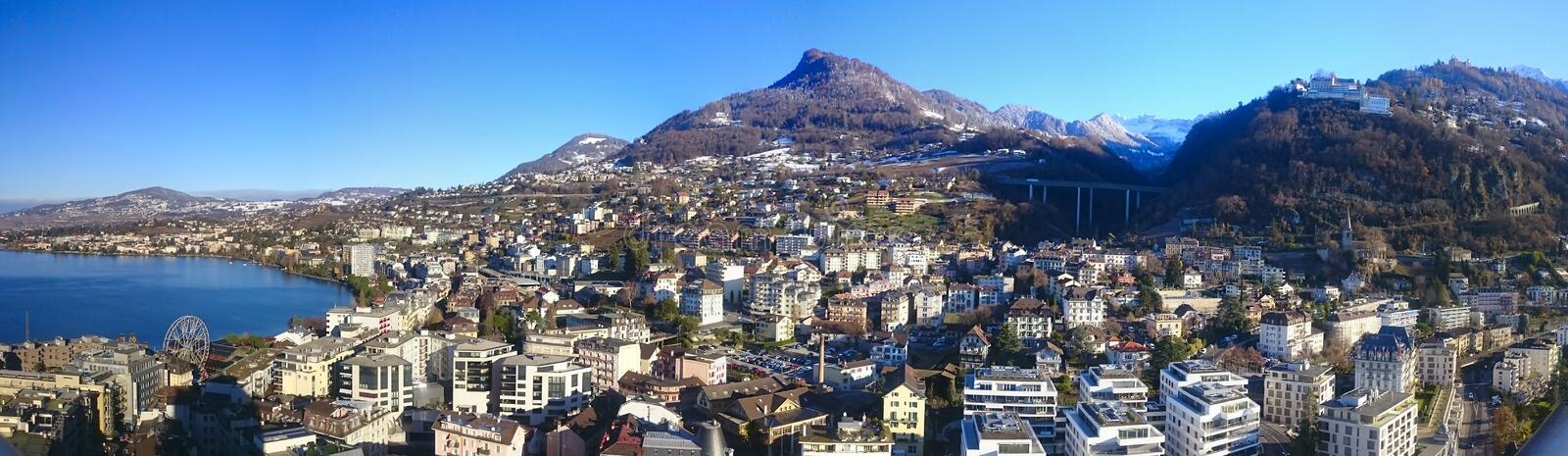 Montreux panoramic view. Panoramic view of the city of Montreux, Lake Geneva and the Alps on a sunny winter day, the canton of Vaud, Switzerland royalty free stock photo