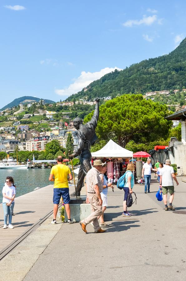 Montreux, Switzerland - July 26, 2019: People on the promenade by Geneva Lake around the statue of Freddie Mercury, lead singer of stock photos