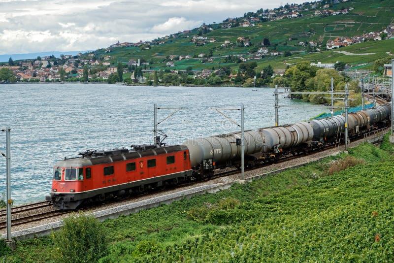 MONTREUX/SWITZERLAND - SEPTEMBER 14 : Freight Train Passing along Lake Geneva near Montreux in Switzerland on September 14, 2015 royalty free stock photos