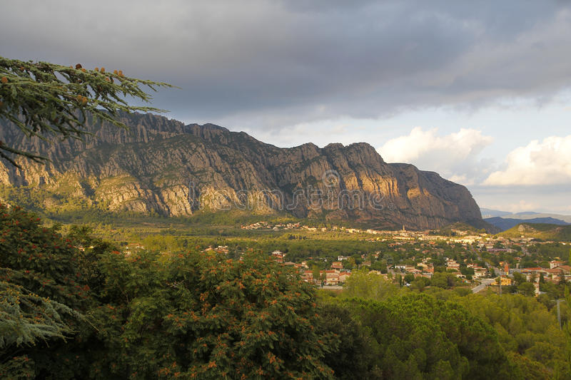 Montserrat mountains and Collbató village. In Catalonia, Spain royalty free stock image