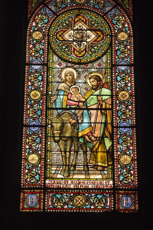 Montserrat, Spain, June 23, 2019: Stained glass window in the Benedictine monastery in Montserrat in Spain showing Jesus, Mary and. Joseph with a donkey fleeing stock photo