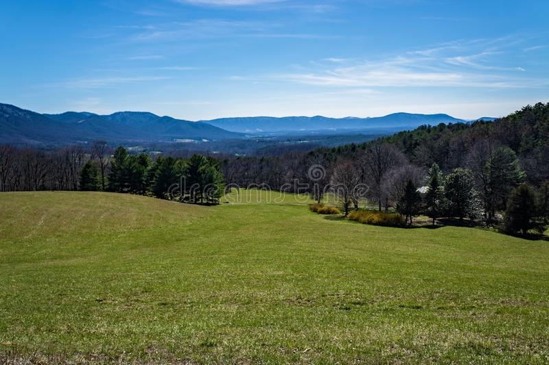 Montville Valley and Mountains. A springtime view a field, Montvale Valley and mountains in the background royalty free stock image