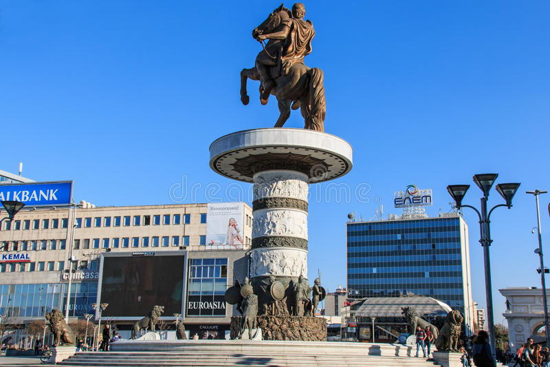 Monument of Alexander The Great in Skopje's main square with people passing by. royalty free stock photography